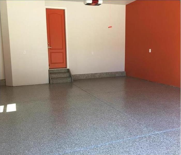 Garage with orange wall and door??