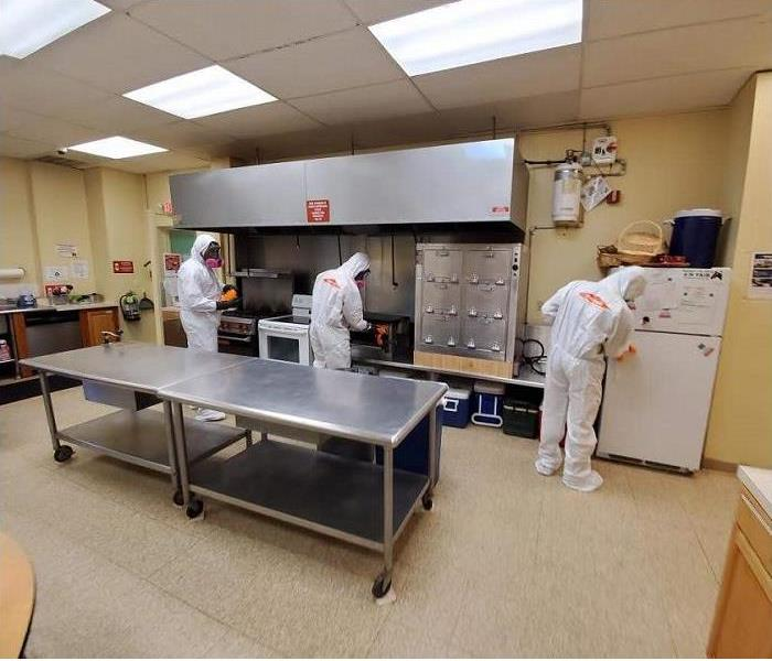 SERVPRO Technicians in PPE Equipment Cleaning a Commercial Kitchen