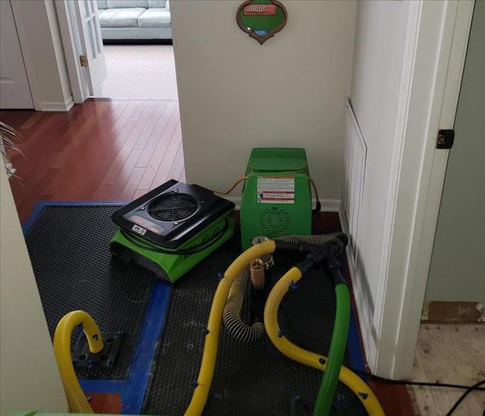 SERVPRO equipment on the kitchen floor