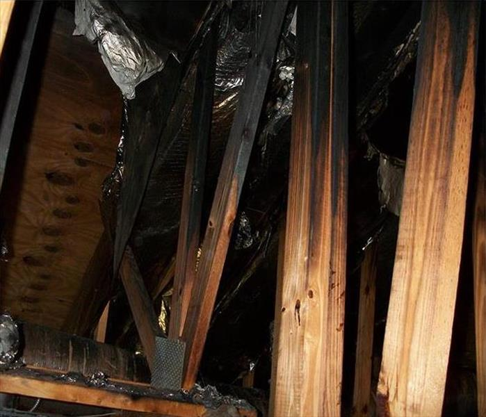 burnt rafters in an attic