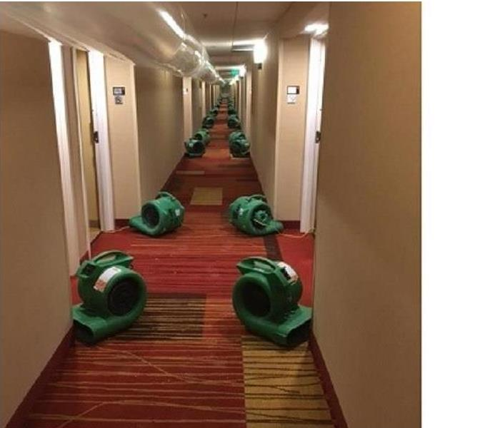 rows of air movers--green in a hallway, about 35 feet running