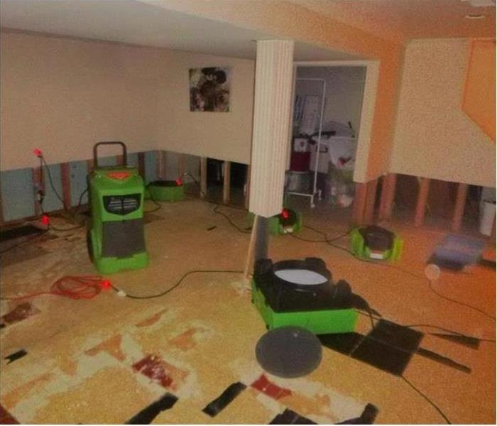 Basement with flood cuts and SERVPRO drying equipment
