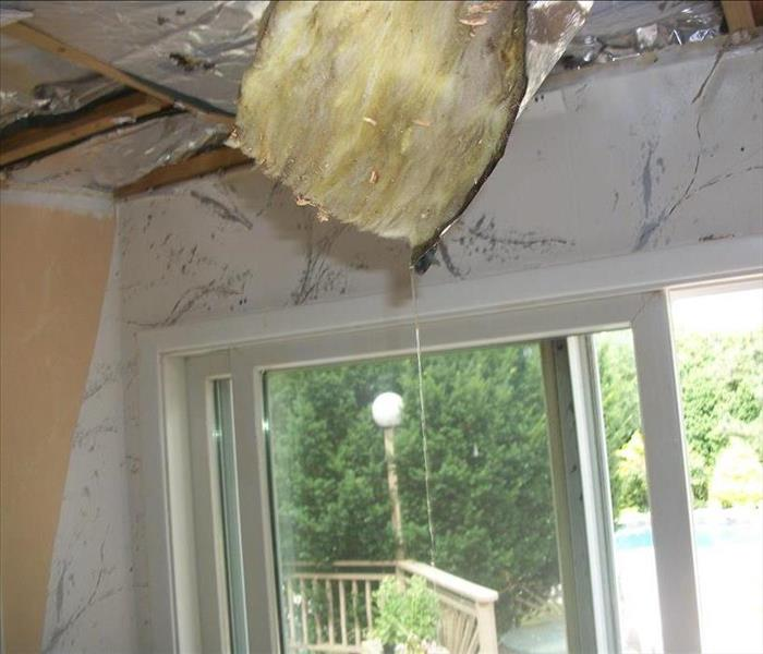 Damaged ceiling with insulation showing